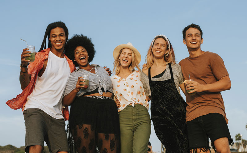 group-of-diverse-friends-hanging-out-at-the-beach